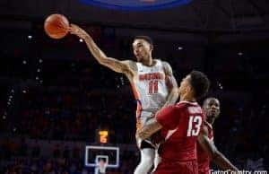 Florida Gators basketball point guard Chris Chiozza passes against Arkansas- 1280x853