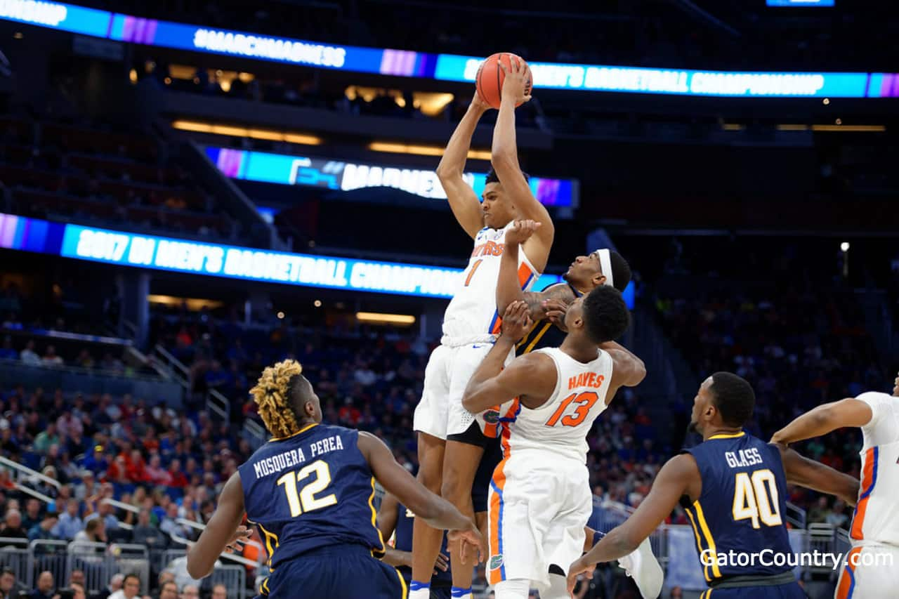 Florida Gators forward Devin Robinson goes up for a rebound in the NCAA tournament- 1280x853