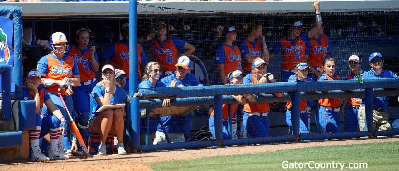 Florida Gators softball team watches on from the dugout- 1280x549