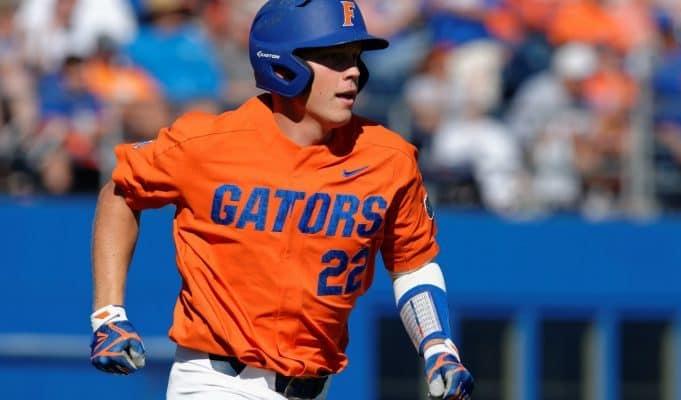 University of Florida catcher JJ Schwarz runs to first base after a single against the Miami Hurricanes- Florida Gators baseball- 1280x852