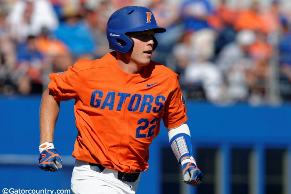 University of Florida catcher JJ Schwarz runs to first base after a single against the Miami Hurricanes- Florida Gators baseball- 1280x852