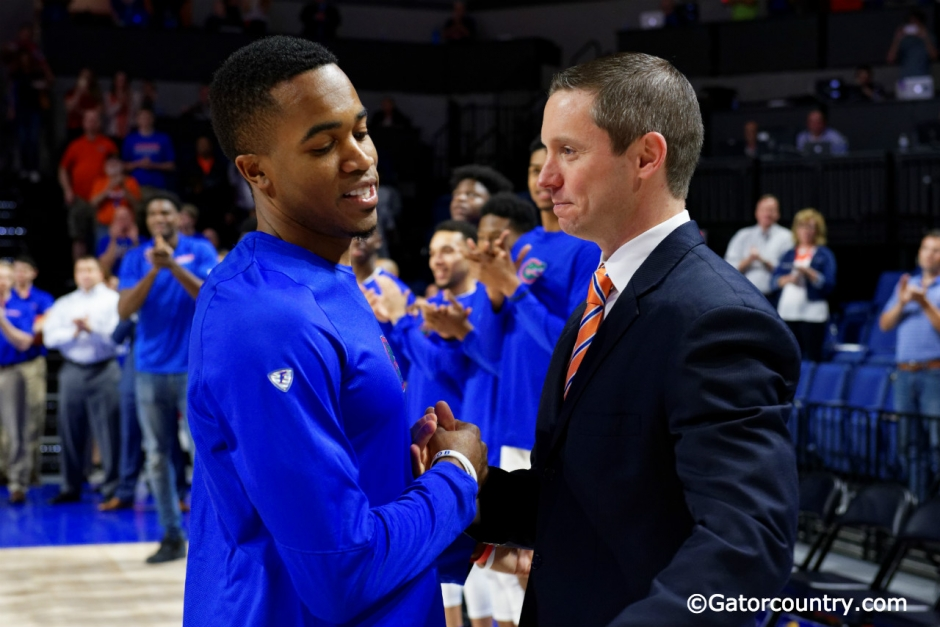University of Florida head coach Mike White greets Kasey Hill during Senior Night ceremonies- Florida Gators basketball- 1820x854
