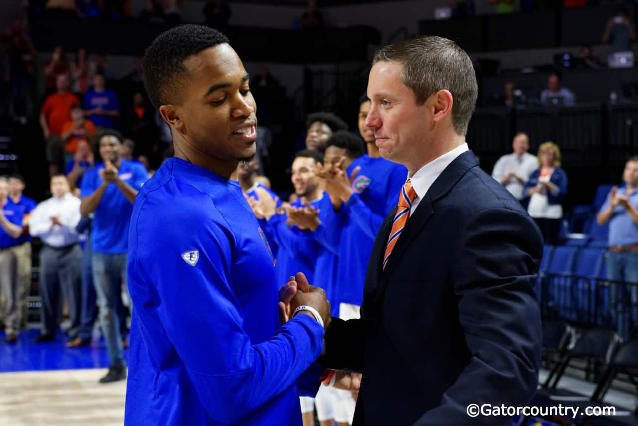 University of Florida head coach Mike White greets Kasey Hill during Senior Night ceremonies- Florida Gators basketball- 1820x854