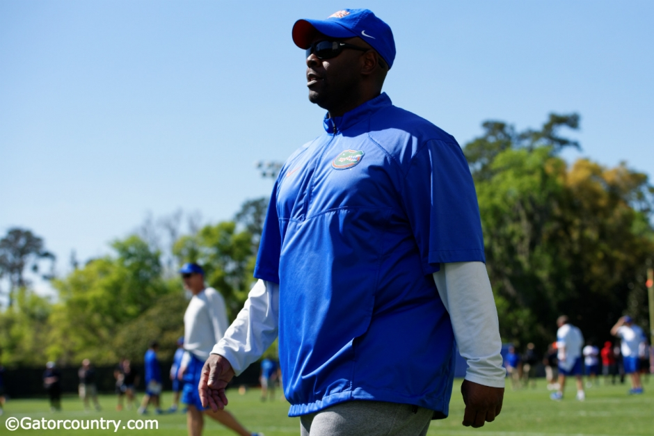 University of Florida linebackers coach Tim Skipper watches the team go through drills during spring practice- Florida Gators football- 1280x854