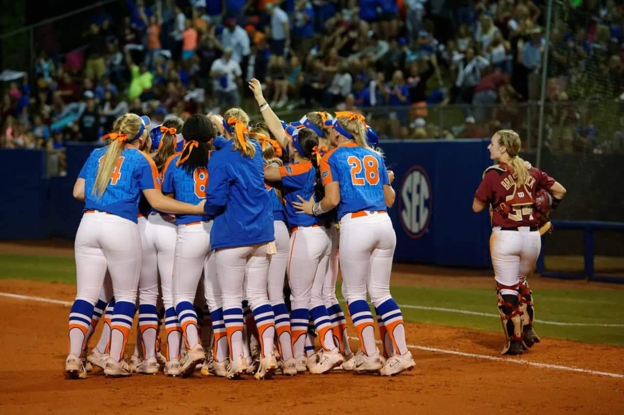 Florida Gators softball team huddles after a big win- 1280x852