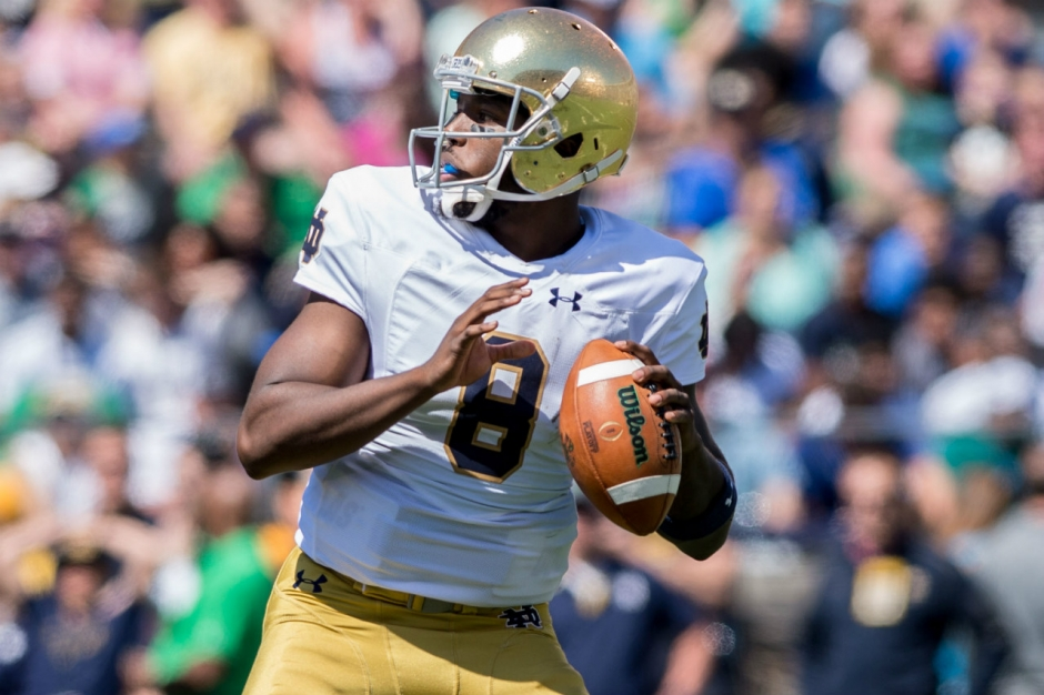 Apr 16, 2016; South Bend, IN, USA; Notre Dame Fighting Irish quarterback Malik Zaire (8) looks to throw in the first quarter of the Blue-Gold Game at Notre Dame Stadium. The Blue team defeated the Gold team 17-7. Mandatory Credit: Matt Cashore-USA TODAY Sports
