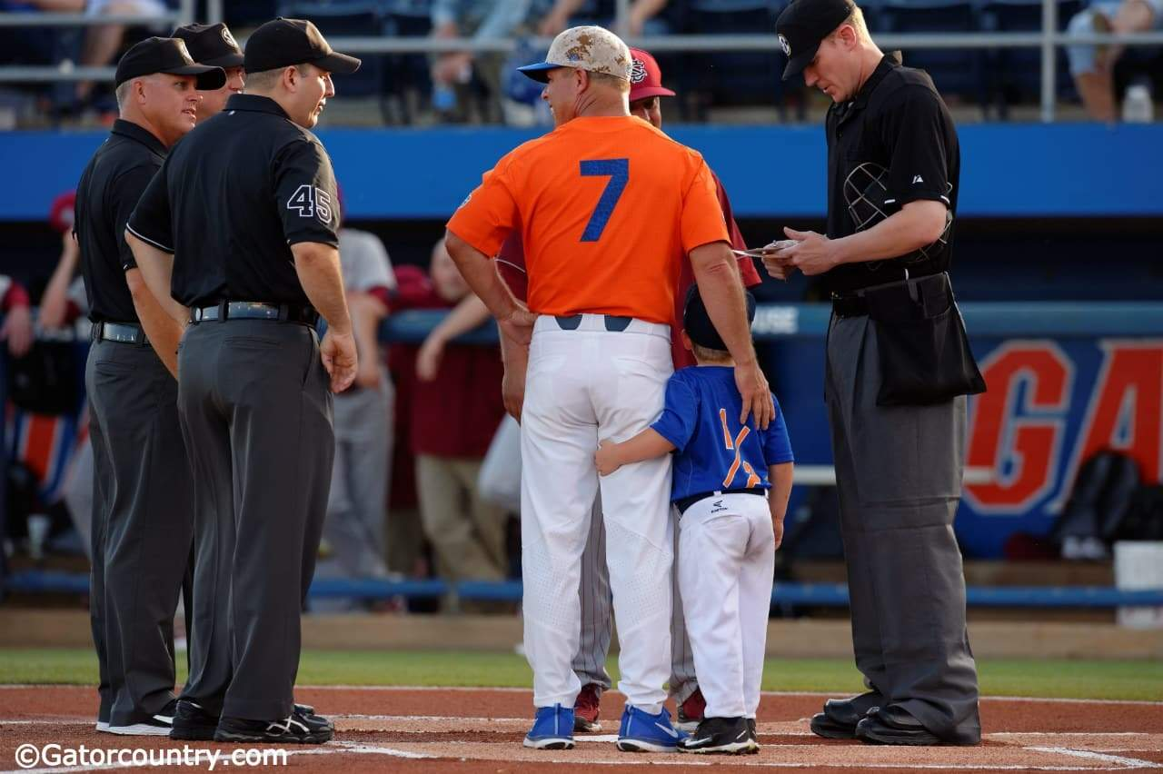 University of Florida head baseball coach Kevin O'Sullivan and his son Finn deliver the starting lineups to the umpire- Florida Gators baseball- 1280x852