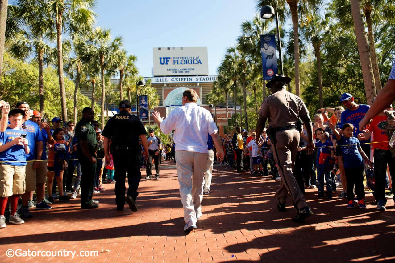 University of Florida head football coach Jim McElwain leads his football team into Ben Hill Griffin Stadium before the Orange and Blue Debut- Florida Gators football- 1280x854