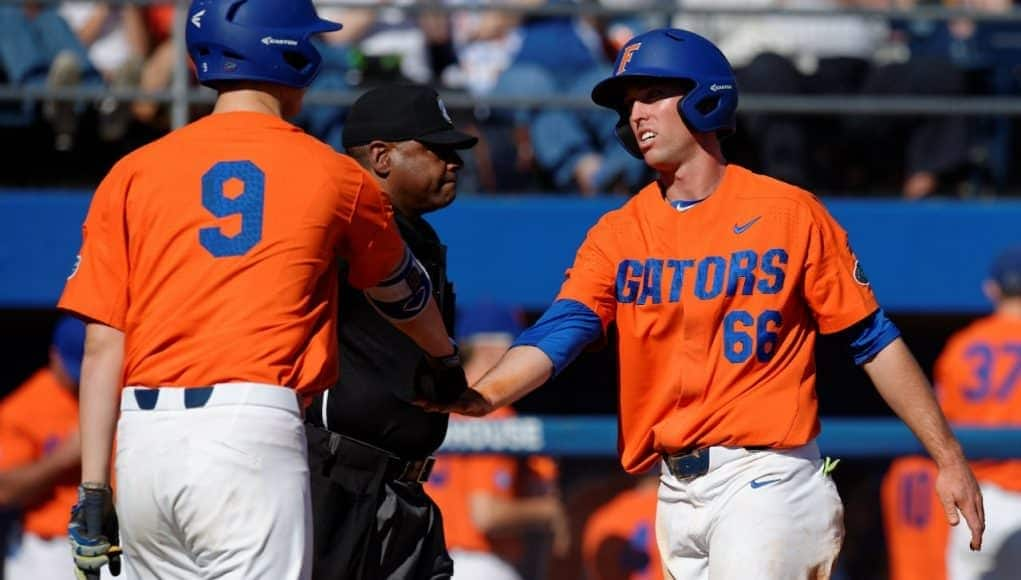 University of Florida outfielder Ryan Larson celebrates with Christian Hicks after scoring a run against Miami- Florida Gators baseball- 1280x852