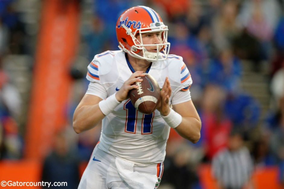 University of Florida quarterback Kyle Trask rolls out before throwing a pass in the Orange and Blue Debut- Florida Gators football- 1280x852