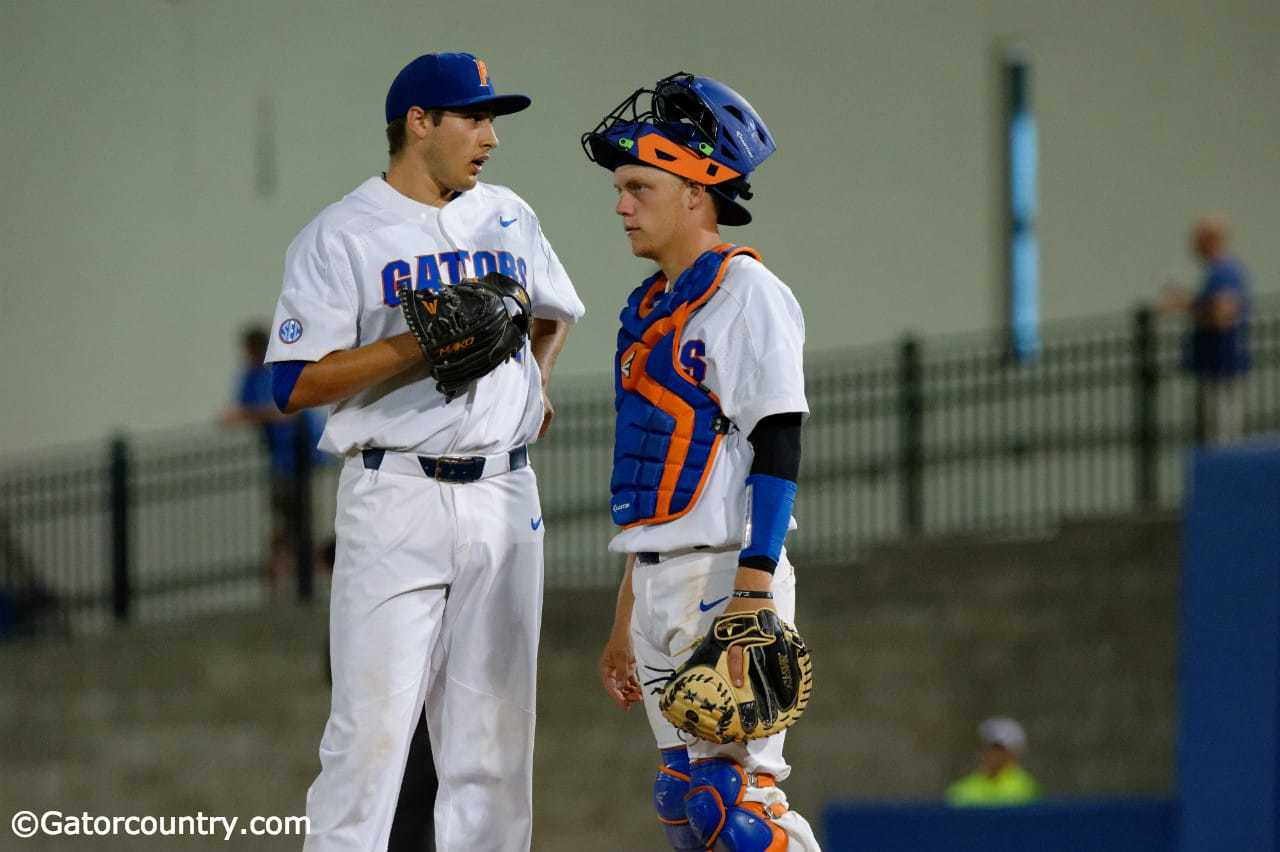 University-of-florida-catcher-jj-schwarz-talks-with-pitcher-alex-faedo-on-the-mound-in-a-loss-to-kentucky-florida-gators-baseball-1280x852