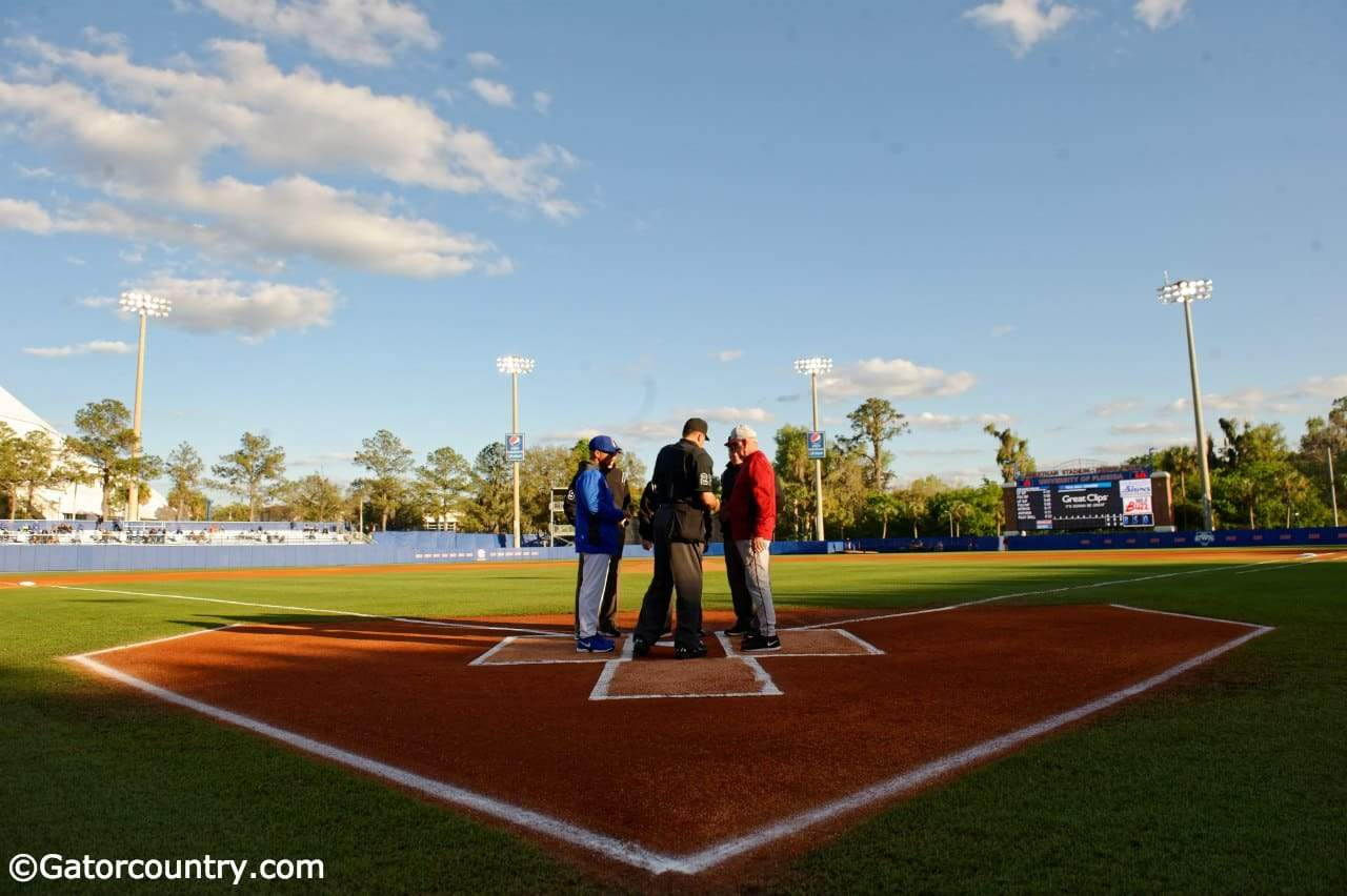University of Florida head coach Kevin O'Sullivan meets with FSU coach Mike Martin to exchange lineups- Florida Gators baseball- 1280x852