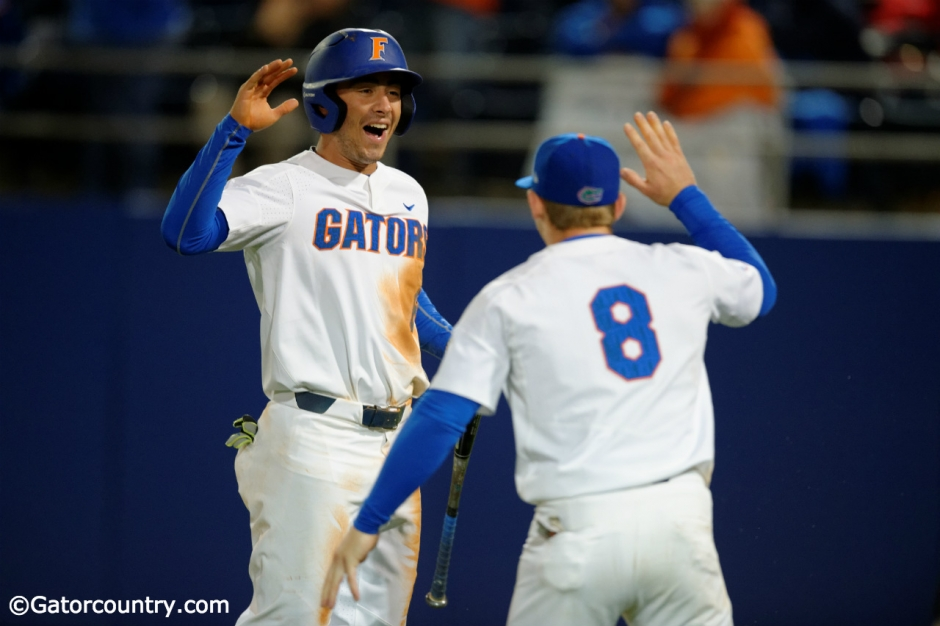 University of Florida infielders Jonathan India (6) and Deacon Liput (8) celebrate after India scored a run against Florida State- Florida Gators baseball- 1280x852