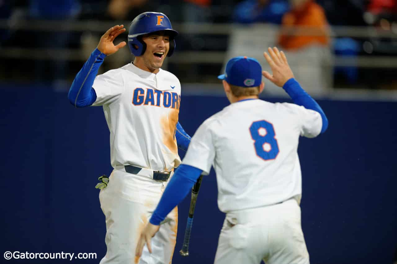 University-of-florida-infielders-jonathan-india-6-and-deacon-liput-8-celebrate-after-india-scored-a-run-against-florida-state-florida-gators-baseball-1280x852