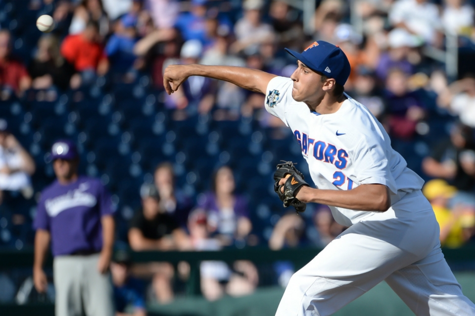 Jun 18, 2017; Omaha, NE, USA; Florida Gators pitcher Alex Faedo (21) pitches in the first inning against the TCU Horned Frogs at TD Ameritrade Park Omaha. Mandatory Credit: Steven Branscombe-USA TODAY Sports