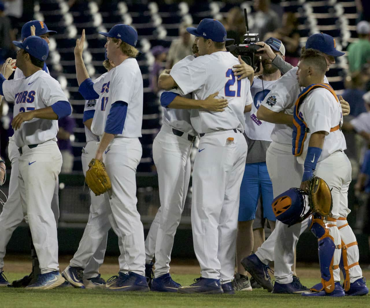 Jun 18, 2017; Omaha, NE, USA; Florida Gators pitcher Alex Faedo (21) and pitcher Michael Byrne (17) celebrate after defeating the TCU Horned Frogs at TD Ameritrade Park Omaha. Florida won 3-0. Mandatory Credit: Bruce Thorson-USA TODAY Sports