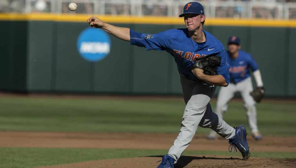 Jun 20, 2017; Omaha, NE, USA; Florida Gators pitcher Brady Singer (51) throws agains the Louisville Cardinals in the first inning at TD Ameritrade Park Omaha. Mandatory Credit: Bruce Thorson-USA TODAY Sports