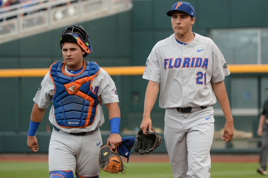 Jun 24, 2017; Omaha, NE, USA; Florida Gators pitcher Alex Faedo (21) and catcher Mike Rivera (4) walk to the dugout before the game against the TCU Horned Frogs at TD Ameritrade Park Omaha. Mandatory Credit: Steven Branscombe-USA TODAY Sports