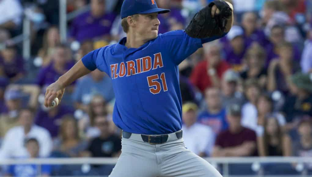 Jun 26, 2017; Omaha, NE, USA; Florida Gators pitcher Brady Singer (51) throws against the LSU Tigers in the first inning in game one of the championship series of the 2017 College World Series at TD Ameritrade Park Omaha. Mandatory Credit: Bruce Thorson-USA TODAY Sports