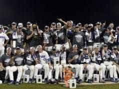 Jun 27, 2017; Omaha, NE, USA; Florida Gators players and coaches celebrate with the national championship trophy after the game against the LSU Tigers in game two of the championship series of the 2017 College World Series at TD Ameritrade Park Omaha. Mandatory Credit: Steven Branscombe-USA TODAY Sports