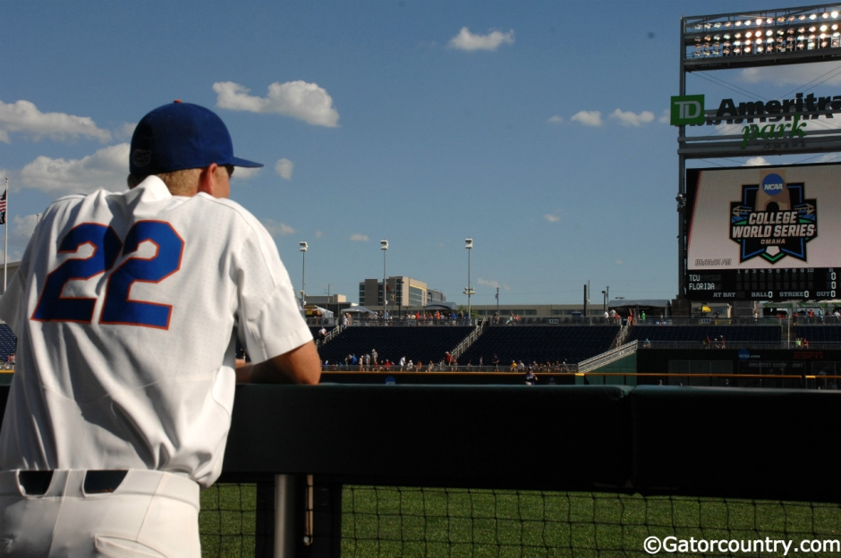 University of Florida catcher JJ Schwarz watches TCU take infield before the Gators and Frogs play in the College World Series- Florida Gators baseball- 1280x850