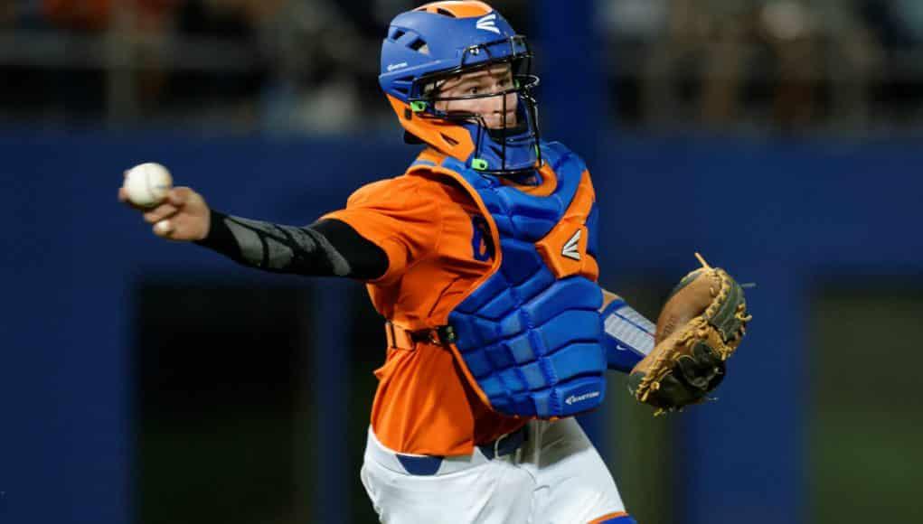 University of Florida catcher Mark Kolozsvary fires a baseball to first against South Carolina- Florida Gators baseball- 1280x852