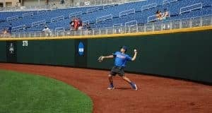 University of Florida outfielder/pitcher Nick Horvath throws a ball into the infield during practice in Omaha- Florida Gators baseball- 1280x850
