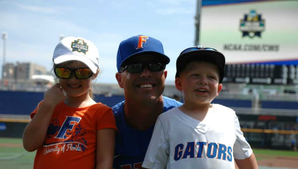 University of Florida head coach Kevin O'Sullivan poses with his kids, Payton and Finn, in Omaha at the College World Series- Florida Gators baseball- 1280x850