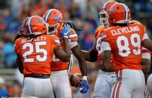 University of Florida running back Jordan Scarlett celebrates with C'yontai Lewis after scoring a touchdown in the 2017 Orange and Blue Debut- Florida Gators football- 1280x852