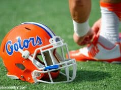 A Florida Gators helmet rests on the field as the Gators get ready to take on Michigan before the 2016 Buffalo Wild Wings Bowl- Florida Gators football- 1280x852