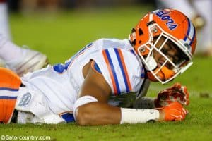 University of Florida defensive back Jeawon Taylor on the ground at Doak Campbell Stadium after injuring his shoulder against FSU- Florida Gators football- 1280x852