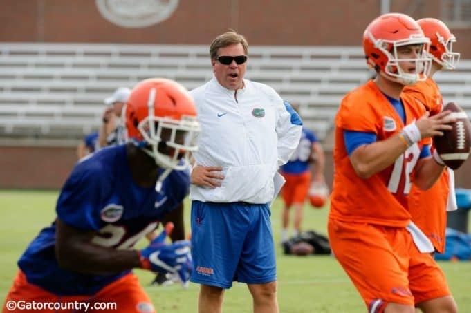 University of Florida head coach Jim McElwain watches as Jake Allen goes through a rep during 2017 fall camp- Florida Gators football- 1280x852
