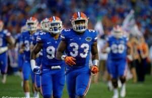 University of Florida linebacker David Reese runs onto Florida Field before the Gators game against Michigan- Florida Gators football- 1280x852