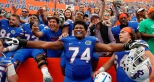 University of Florida offensive lineman Fred Johnson celebrates with his teammates and fans after the Florida Gators win over South Carolina in 2016- Florida Gators football- 1280x852