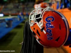 A Florida Gators helmet rests on a fence during the 2017 Orange and Blue Debut- Florida Gators football- 1280x852