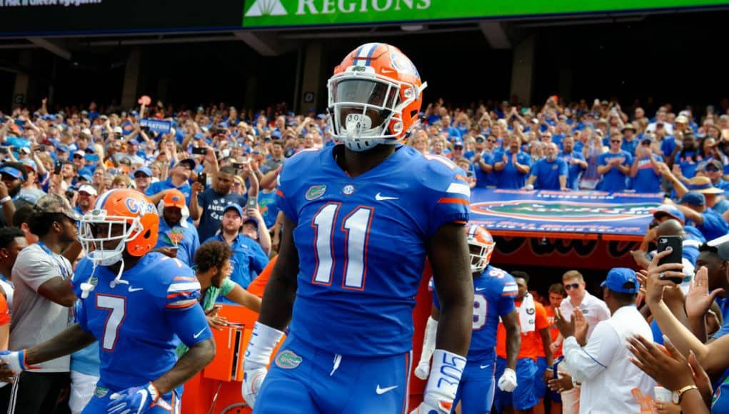 Florida Gators linebacker Vosean Joseph runs out of the tunnel- 1280x852