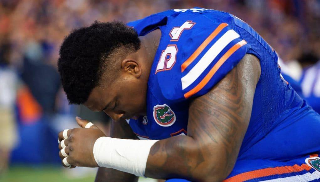 University of Florida defensive tackle Khairi Clark prays before the Florida Gators season opener against UMass in 2016- Florida Gators football- 1280x854