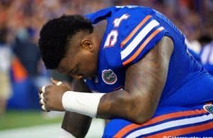University of Florida defensive tackle Khairi Clark prays before the Florida Gators season opener against UMass in 2016- Florida Gators football- 1280x854