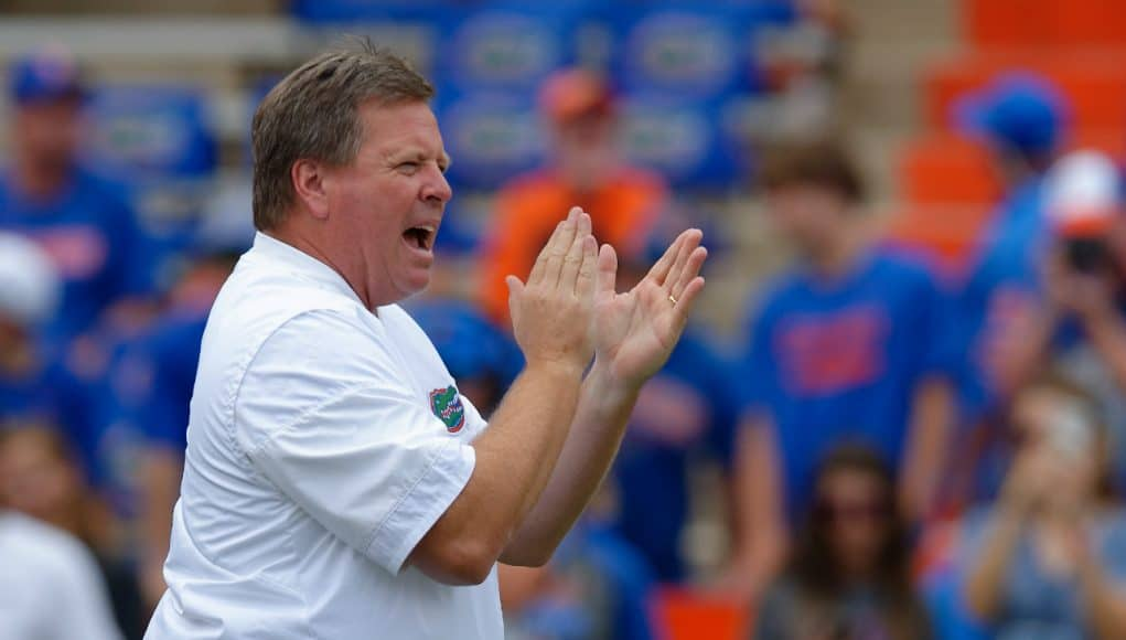 University of Florida head coach Jim McElwain cheers on his team as they warm up for their game against the Tennessee Volunteers- Florida Gators football- 1820x852