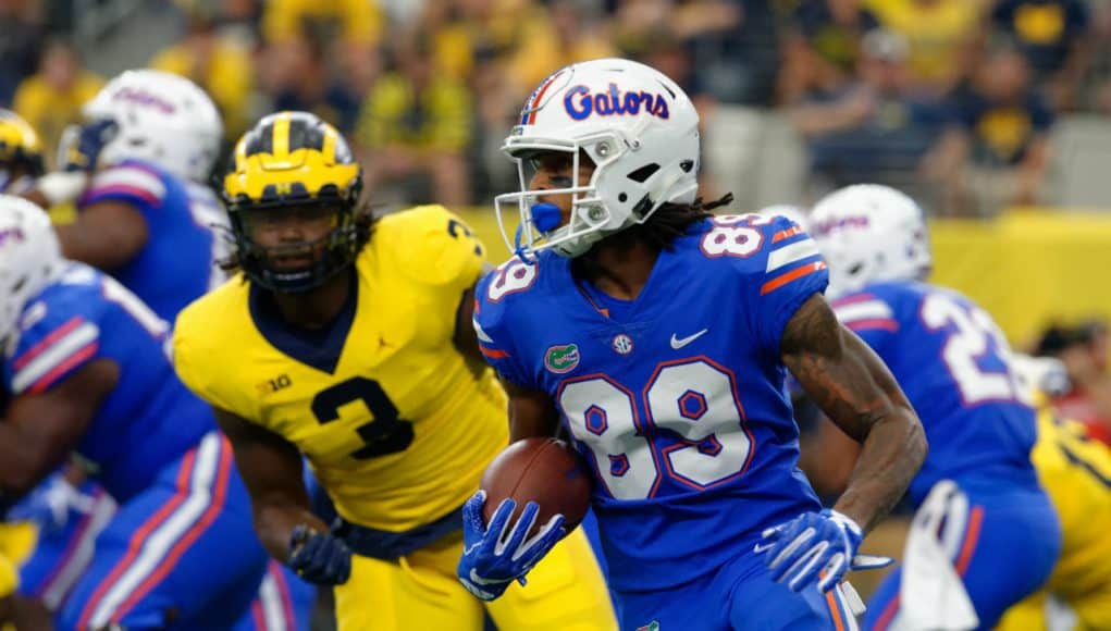 University of Florida receiver Tyrie Cleveland runs after a reception while Michigan's Rashan Gary chases- Florida Gators football- 1280x852