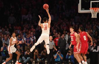 Mar 24, 2017; New York, NY, USA; Florida Gators guard Chris Chiozza (11) makes a three point basket to beat the Wisconsin Badgers in overtime in the semifinals of the East Regional of the 2017 NCAA Tournament at Madison Square Garden. Mandatory Credit: Robert Deutsch-USA TODAY Sports