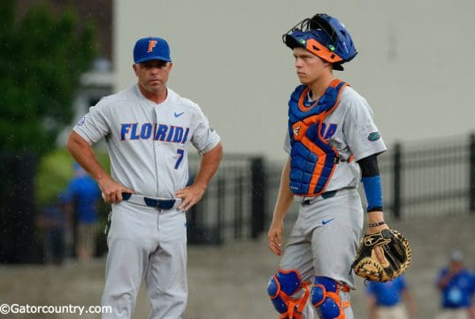 University of Florida head baseball coach Kevin O'Sullivan and catcher JJ Schwarz wait for a new pitcher in a win over Wake Forest- Florida Gators baseball- 1280x852