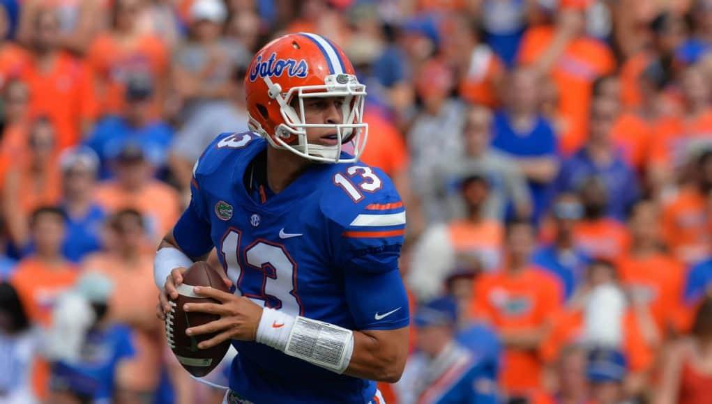 University of Florida quarterback Feleipe Franks rolls out to throw a pass against the LSU Tigers- Florida Gators football- 1280x851