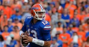 University of Florida quarterback Feleipe Franks rolls out to throw a pass against the LSU Tigers- Florida Gators football- 1280x851