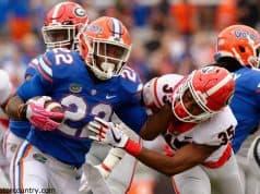 University of Florida running back Lamical Perine stiff arms a Georgia defender- Florida Gators football- 1280x852