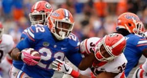 University of Florida running back Lamical Perine stiff arms a Georgia defender- Florida Gators football- 1280x852