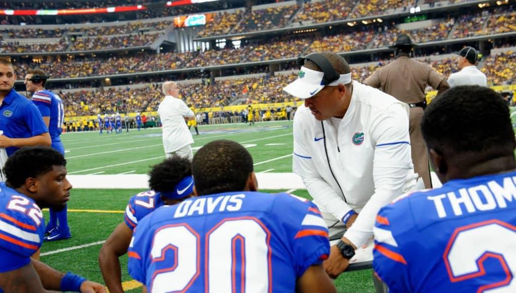 University of Florida running backs coach Ja'Juan Seider coaches his players during the Florida Gators game against the Michigan Wolverines- Florida Gators football- 1280x852