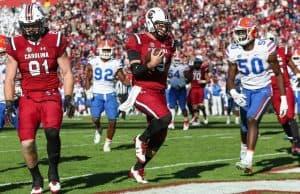 Nov 11, 2017; Columbia, SC, USA; South Carolina Gamecocks quarterback Jake Bentley (19) runs into the end zone to score a touchdown against the Florida Gators during the second half at Williams-Brice Stadium. Mandatory Credit: Jim Dedmon-USA TODAY Sports