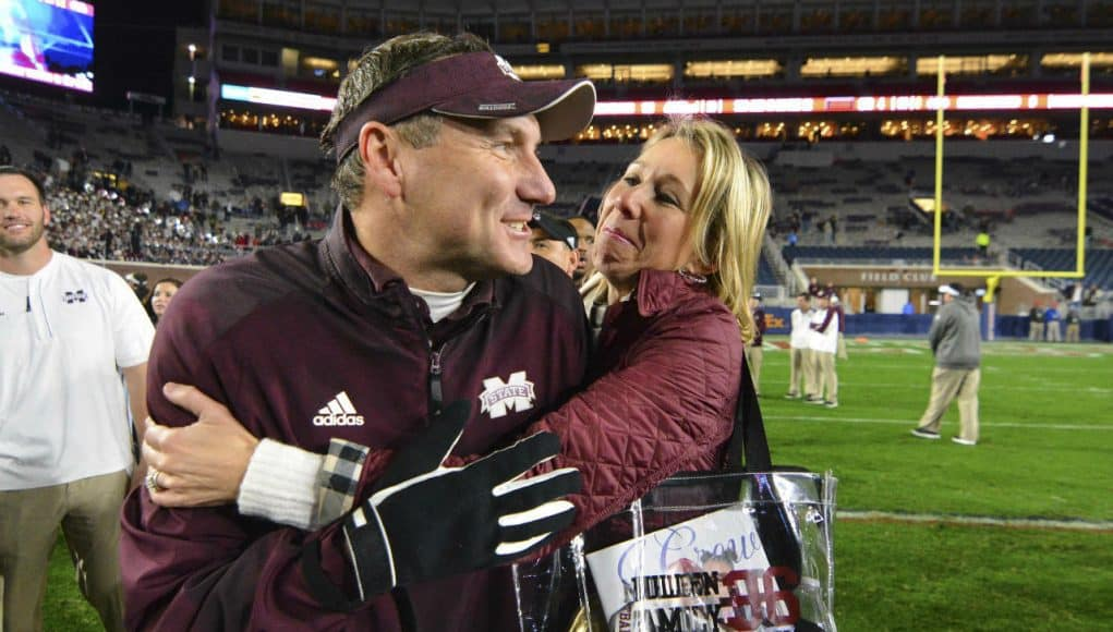 Nov 26, 2016; Oxford, MS, USA; Mississippi State Bulldogs head coach Dan Mullen is embraced by his wife Megan Mullen after the game against the Mississippi Rebels at Vaught-Hemingway Stadium. Mississippi State won 55-20 Mandatory Credit: Matt Bush-USA TODAY Sports