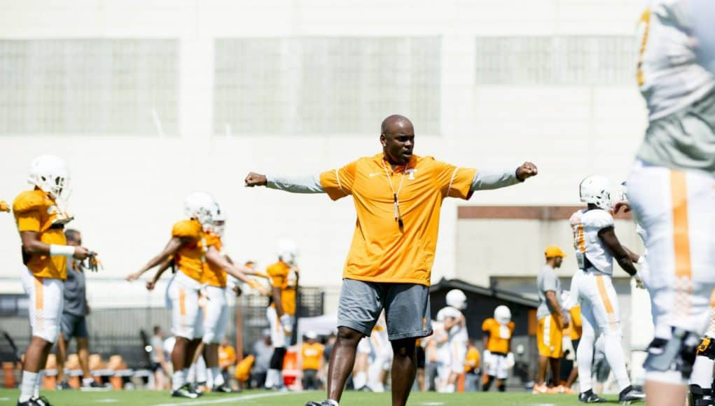 Aug 18, 2017; Knoxville, TN, USA; Tennessee Volunteers defensive backs coach Charlton Warren warms up with players during fall football practice at Anderson Training Facility. Mandatory Credit: Calvin Mattheis/Knoxville News Sentinel via USA TODAY NETWORK